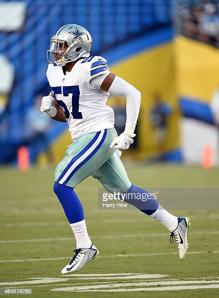 Damien Wilson of the Dallas Cowboys leaves the game against the San Diego Chargers at Qualcomm Stadium on August 13 2015 in San Diego California