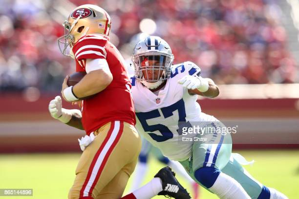 Damien Wilson of the Dallas Cowboys tackles CJ Beathard of the San Francisco 49ers during their NFL game at Levi's Stadium on October 22 2017 in...