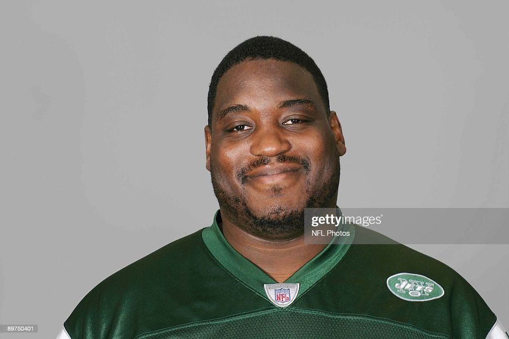 Damien Woody of the New York Jets poses for his 2009 NFL headshot at photo day in East Rutherford, New Jersey.