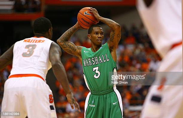 Damier Pitts of the Marshall Thundering Herd looks to pass against the Syracuse Orange during the game at the Carrier Dome on December 6 2011 in...