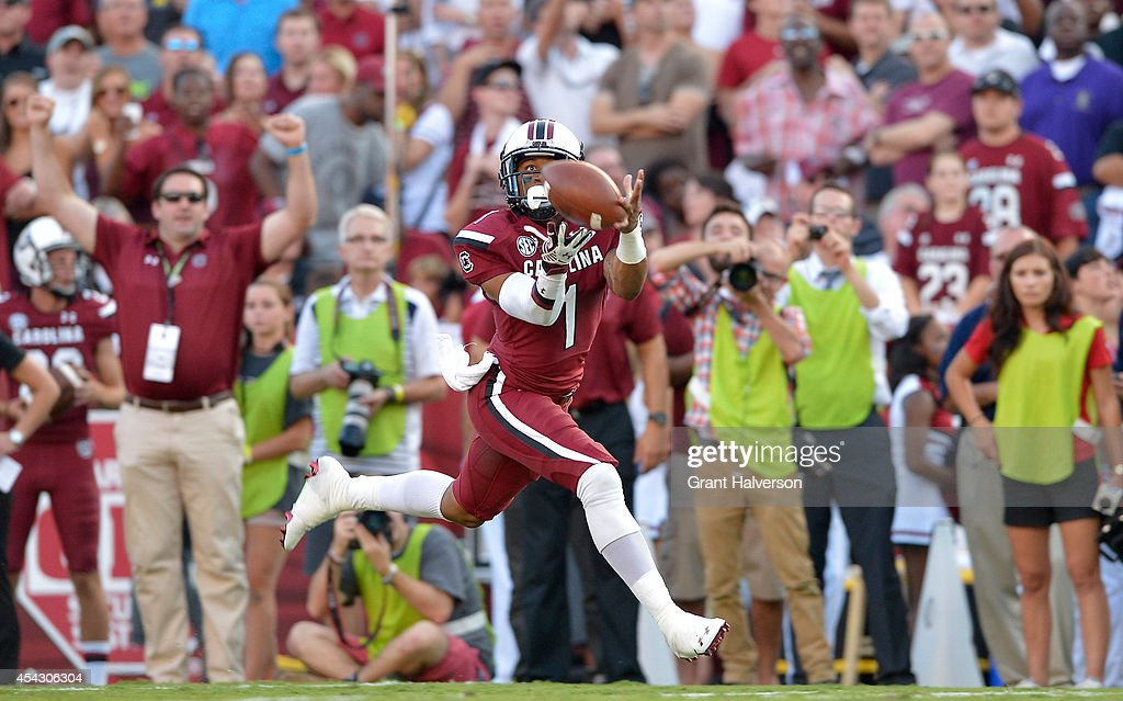 Damiere Byrd #1 of the South Carolina Gamecocks makes a touchdown catch against the Texas A&M Aggies during their game at Williams-Brice Stadium on August 28, 2014 in Columbia, South Carolina.