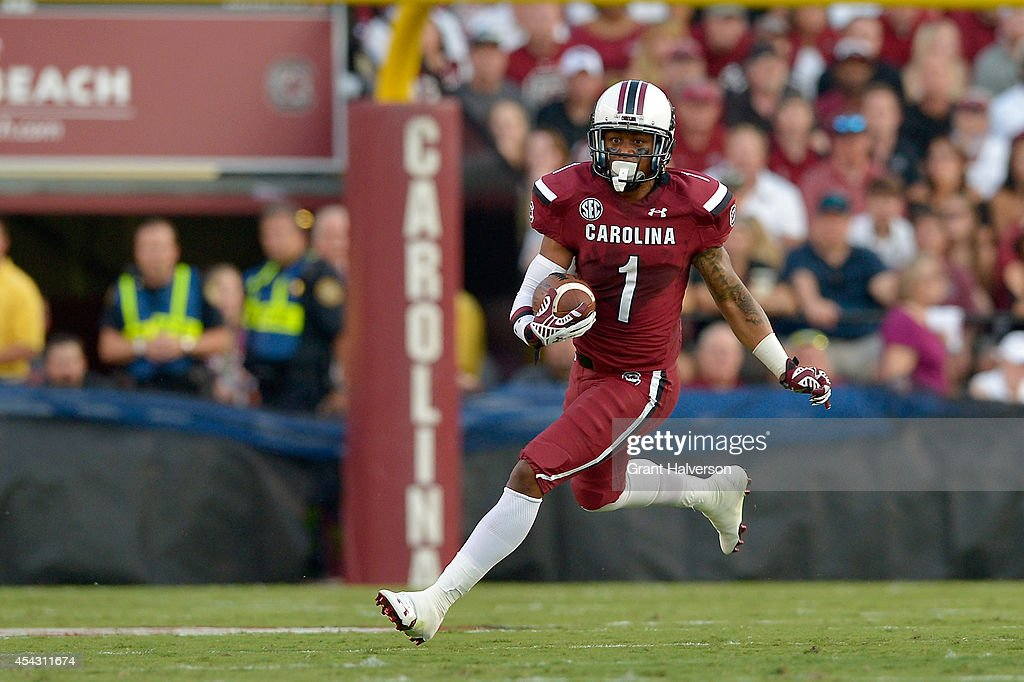 Damiere Byrd #1 of the South Carolina Gamecocks runs against the Texas A&M Aggies during their game at Williams-Brice Stadium on August 28, 2014 in Columbia, South Carolina.