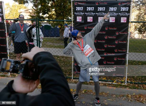 Damion Dudley poses for a photo after crossing the finish line at the 8th annual Transamerica Rock n' Roll Half Marathon at Civic Center Park on...