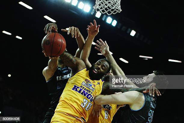 Damion James of the Kings is blocked by Tai Wesley of the Breakers and Alex Pledger of the Breakers during the round 10 NBL match between the New...
