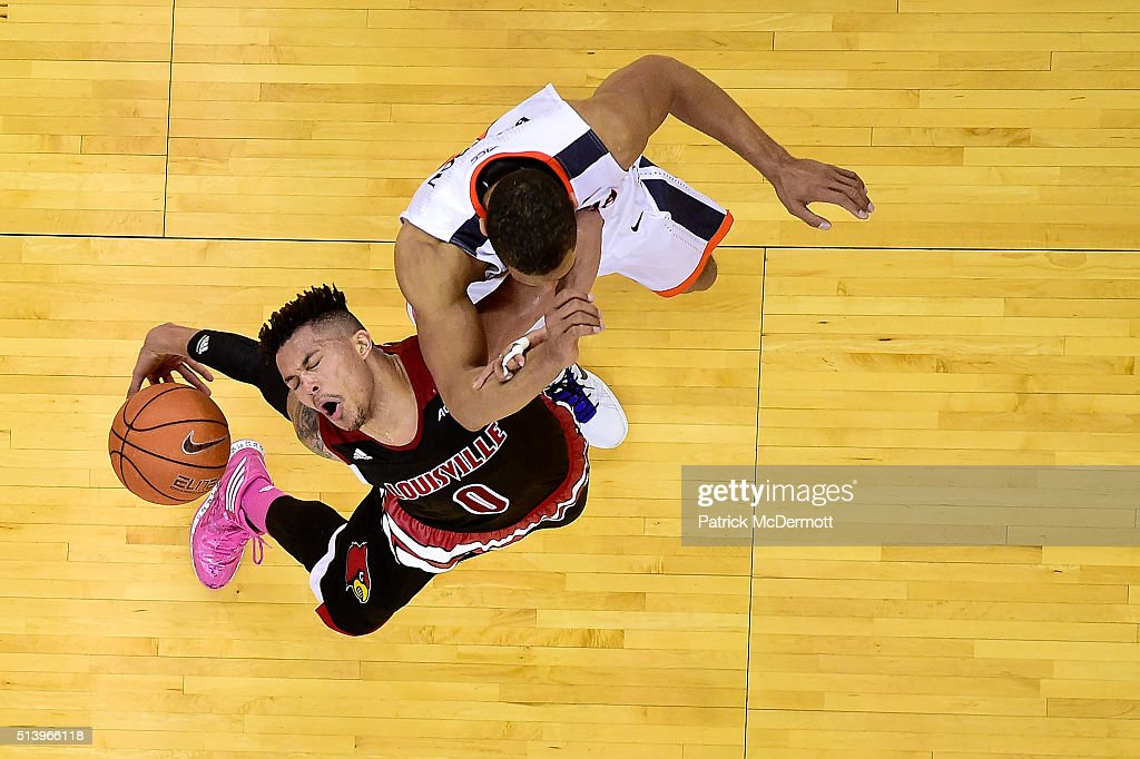 Damion Lee #0 of the Louisville Cardinals dribbles the ball against <a gi-track='captionPersonalityLinkClicked' href=/galleries/search?phrase=Malcolm+Brogdon&family=editorial&specificpeople=8768599 ng-click='$event.stopPropagation()'>Malcolm Brogdon</a> #15 of the Virginia Cavaliers in the second half during their game at John Paul Jones Arena on March 5, 2016 in Charlottesville, Virginia. The Virginia Cavaliers defeated the Louisville Cardinals 68-46.
