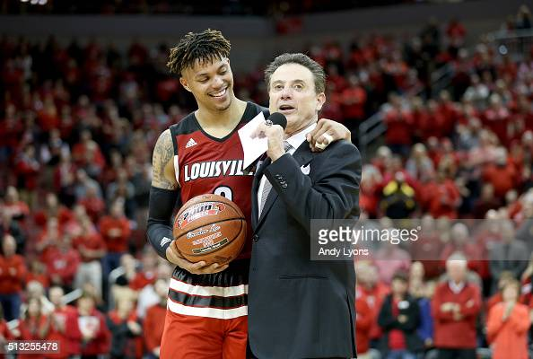 Damion Lee of the Louisville Cardinals hugs head coach Rick Pitino as he talks to the crowd following the 5653 win over the Georgia Tech Yellow...