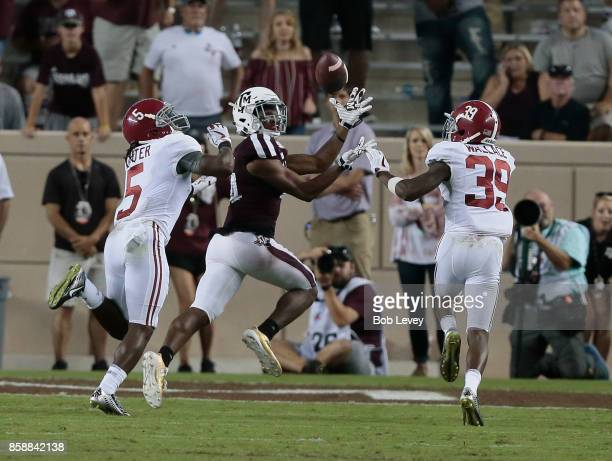 Damion Ratley of the Texas AM Aggies makes a pass as he beats Ronnie Clark of the Alabama Crimson Tide and Levi Wallace in the fourth quarter at Kyle...