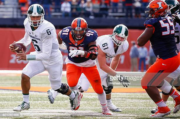 Damion Terry of the Michigan State Spartans runs the ball during the game as Dawuane Smoot of the Illinois Fighting Illini pursues at Memorial...