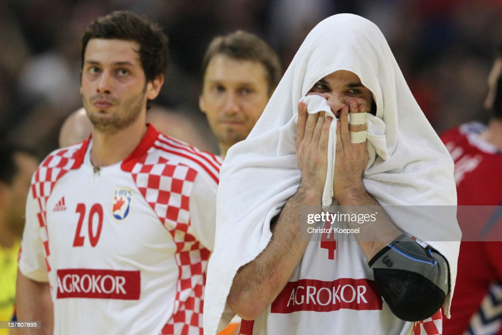 Damir Bicanic and <a gi-track='captionPersonalityLinkClicked' href=/galleries/search?phrase=Ivano+Balic&family=editorial&specificpeople=727804 ng-click='$event.stopPropagation()'>Ivano Balic</a> of Croatia looks dejected after losing 22-26 the Men's European Handball Championship second semi final match between Serbia and Croatia at Beogradska Arena on January 27, 2012 in Belgrade, Serbia.