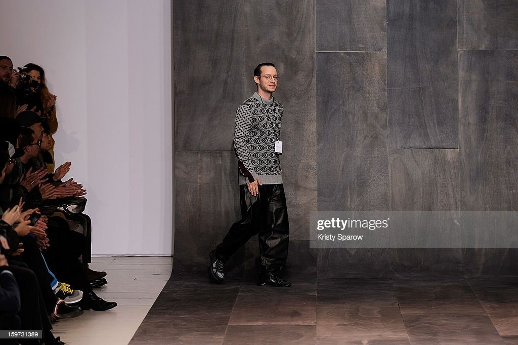 Damir Doma acknowledges the public following the Damir Doma Menswear Autumn / Winter 2013/14 show as part of Paris Fashion Week on January 19, 2013 in Paris, France.
