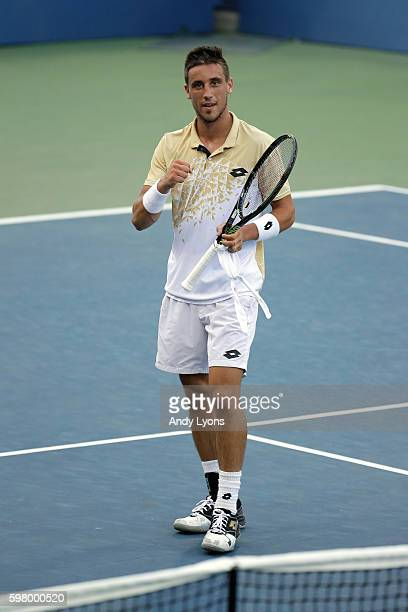 Damir Dzumhur of Bosnia and Herzegovina celebrates after defeating Bernard Tomic of Australia in his first round Men's Singles match on Day Two of...