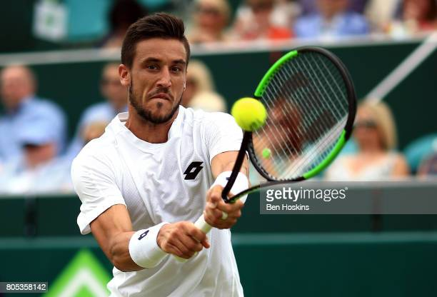 Damir Dzumhur of Bosnia and Herzegovina hits a backhand during his match against Thanasi Kokkinakis of Australia day five of The Boodles Tennis Event...