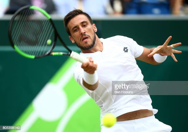 Damir Dzumhur of Bosnia and Herzegovina hits a forehand during his match against Thanasi Kokkinakis of Australia day five of The Boodles Tennis Event...