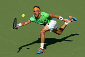 Damir Dzumhur of Bosnia and Herzegovina lunges for a shot against Rafael Nadal of Spain during the Miami Open presented by Itau at Crandon Park...
