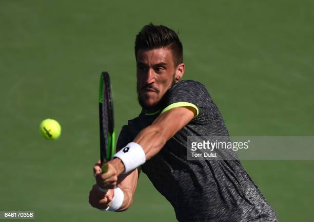 Damir Dzumhur of Bosnia and Herzegovina plays a backhand during his match against Stan Wawrinka of Switzerland on day three of the ATP Dubai Duty...