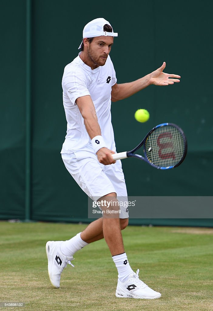 Damir Dzumhur of Bosnia and Herzegovina plays a backhand during the Men's Singles second round match against Pierre-Hughes Herbert on day four of the Wimbledon Lawn Tennis Championships at the All England Lawn Tennis and Croquet Club on June 30, 2016 in London, England.