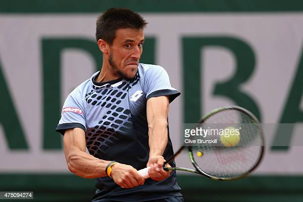 Damir Dzumhur of Bosnia and Herzegovina plays a backhand in his Men's Singles match against Roger Federer of Switzerland on day six of the 2015...
