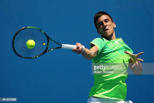 Damir Dzumhur of Bosnia and Herzegovina plays a forehand in his qualifying match against Tim Puetz of Germany for 2015 Australian Open at Melbourne...