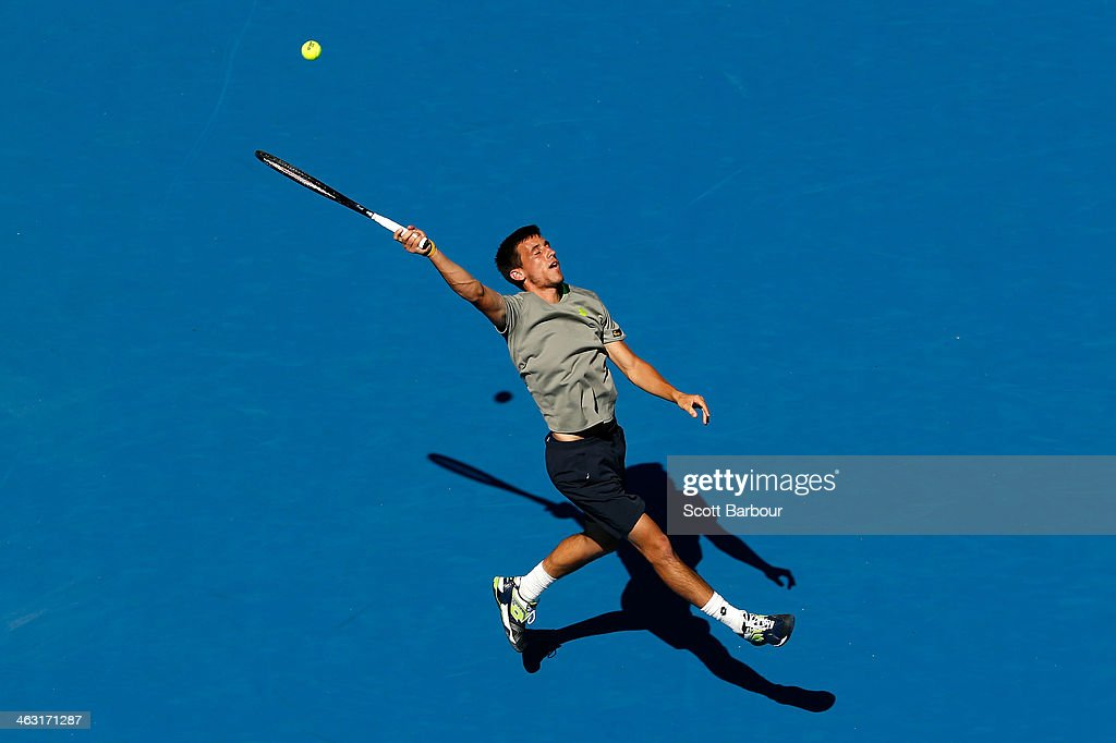 Damir Dzumhur of Bosnia and Herzegovina plays a forehand in his third round match against Tomas Berdych of the Czech Republic during day five of the 2014 Australian Open at Melbourne Park on January 17, 2014 in Melbourne, Australia.