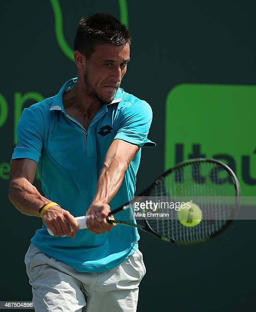 Damir Dzumhur of Bosnia and Herzegovina plays a match against Marinko Matosevic of Australia during Day 3 at the Miami Open at Crandon Park Tennis...
