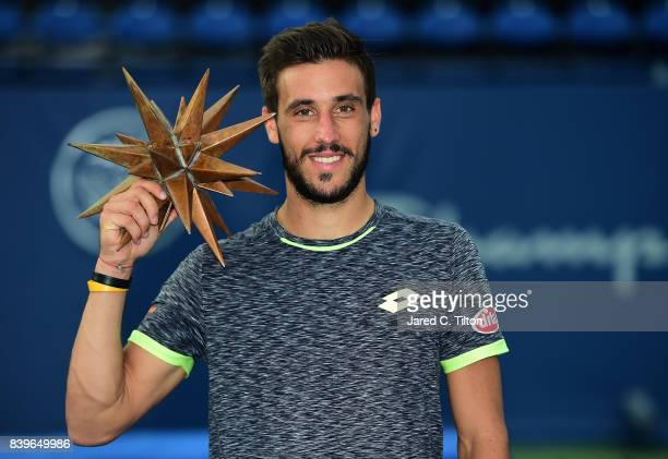 Damir Dzumhur of Bosnia and Herzegovina poses with the finalist's trophy after finishing runnerup to Roberto Bautista Agut of Spain in the men's...