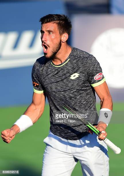 Damir Dzumhur of Bosnia and Herzegovina reacts after winning his match against Hyeon Chung of Korea during their quarterfinals match of the...