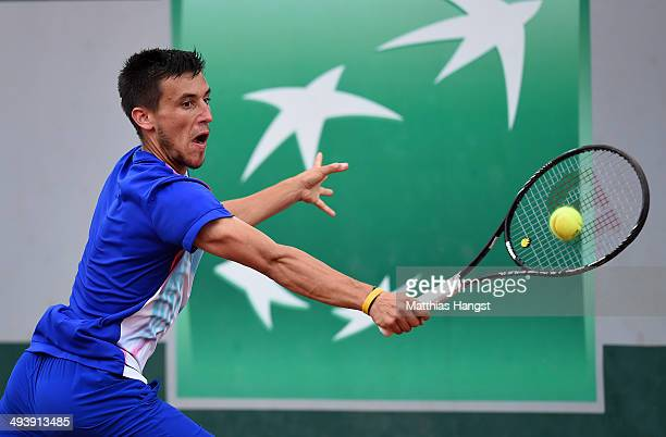 Damir Dzumhur of Bosnia and Herzegovina returns a shot during his men's singles match against Feliciano Lopez of Spain on day two of the French Open...
