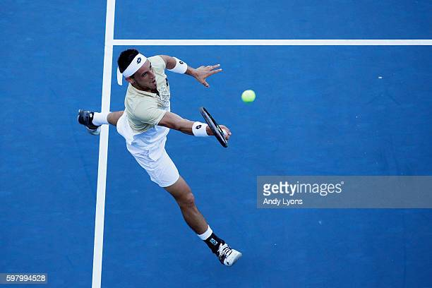 Damir Dzumhur of Bosnia and Herzegovina returns a shot to Bernard Tomic of Australia during his first round Men's Singles match on Day Two of the...