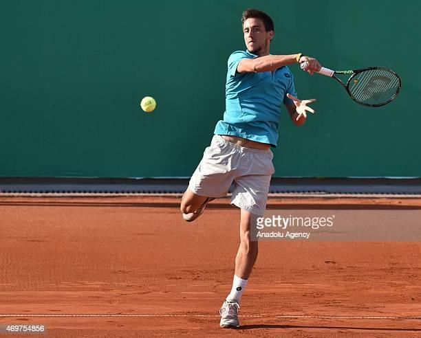 Damir Dzumhur of Bosnia and Herzegovina returns the ball to Cem Ilkel of Turkey during their men's singles tennis match at 4th Mersincup ATP...