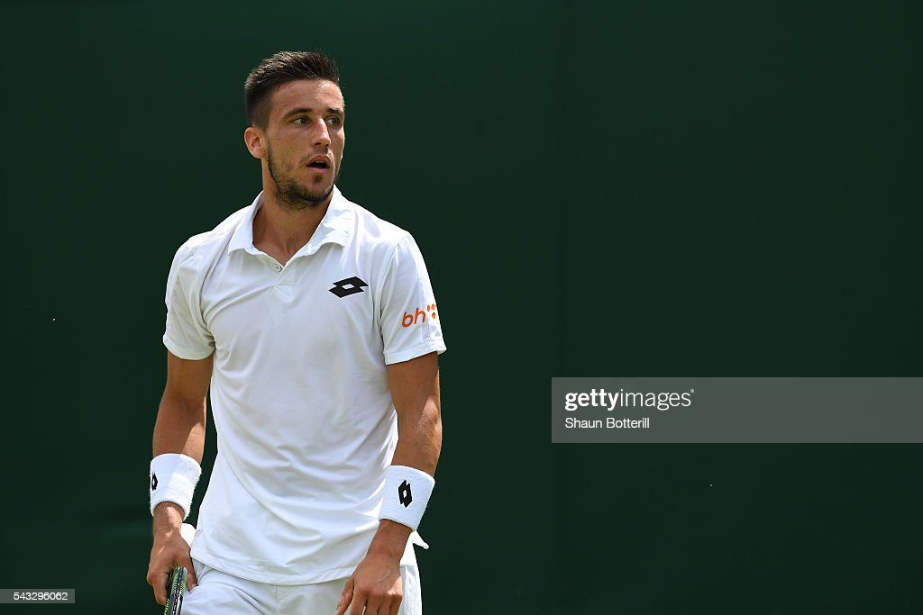 <a gi-track='captionPersonalityLinkClicked' href=/galleries/search?phrase=Damir+Dzumhur&family=editorial&specificpeople=7075830 ng-click='$event.stopPropagation()'>Damir Dzumhur</a> of Bosnia and Herzegovinalooks on during the Men's Singles first round against Denis Kudla of Ukraine on day one of the Wimbledon Lawn Tennis Championships at the All England Lawn Tennis and Croquet Club on June 27th, 2016 in London, England.
