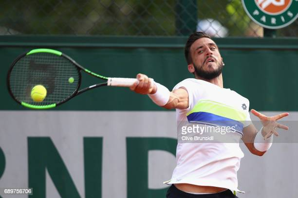 Damir Dzumhur of Bosnia and Herzegovinia plays a forehand during the mens singles first round match against Nicolas Kicker of Argentina on day two of...