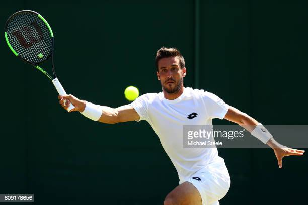 Damir Dzumhur of Bosnia and Herzegovinia plays a forehand during the Gentlemen's Singles second round match against Aljaz Bedene of Great Britain on...