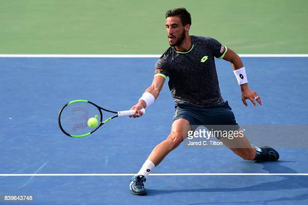 Damir Dzumhur returns a shot to Roberto Bautista Agut of Spain during the men's singles championship final of the WinstonSalem Open at Wake Forest...