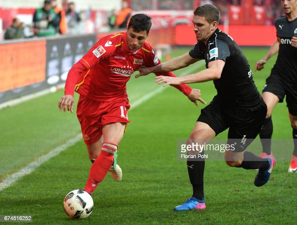 Damir Kreilach of 1 FC Union Berlin and Damian Rossbach of SV Sandhausen during the game between dem 1 FC Union Berlin and dem SV Sandhausen on april...