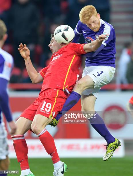 Damir Kreilach of 1 FC Union Berlin and Fabian Kalig of Erzgebirge Aue during the game between Union Berlin and Erzgebirge Aue on april 5 2017 in...
