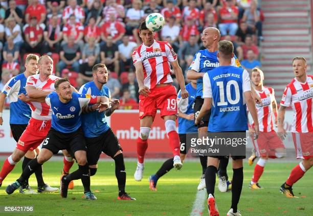 Damir Kreilach of 1 FC Union Berlin and Patrick Hermann of Kieler SV Holstein during the game between Union Berlin and Kieler SV Holstein on august 4...