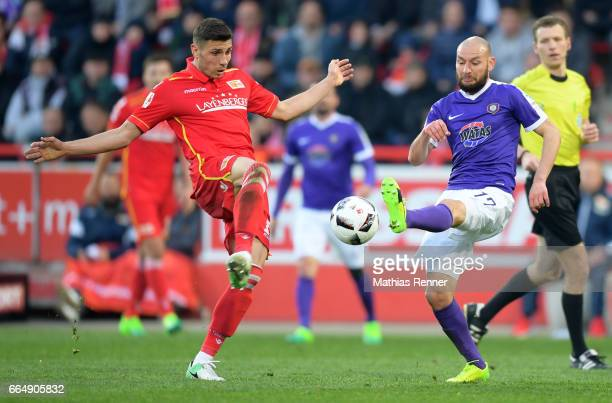 Damir Kreilach of 1 FC Union Berlin and Philipp Riese of Erzgebirge Aue during the game between Union Berlin and Erzgebirge Aue on april 5 2017 in...