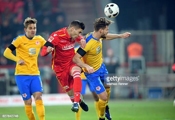 Damir Kreilach of 1 FC Union Berlin and Quirin Moll of Eintracht Braunschweig during the game between dem 1 FC Union Berlin and Eintracht...