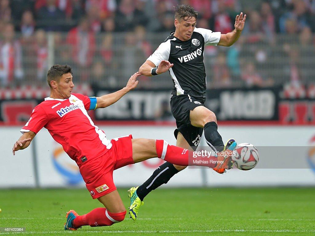 Damir Kreilach of 1 FC Union Berlin and Rene Gartler of SV Sandhausen during the game between 1 FC Union Berlin and SV Sandhausen on october 18 2014...