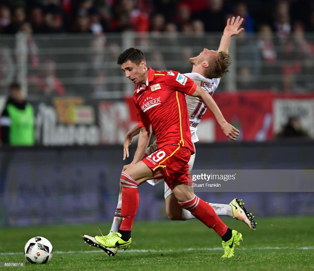 Damir Kreilach of Berlin is challenged by Hanno Behrens of Nuernberg during the Second Bundesliga match between 1. FC Union Berlin and 1. FC Nuernberg at Stadion An der Alten Foersterei on March 20, 2017 in Berlin, Germany.