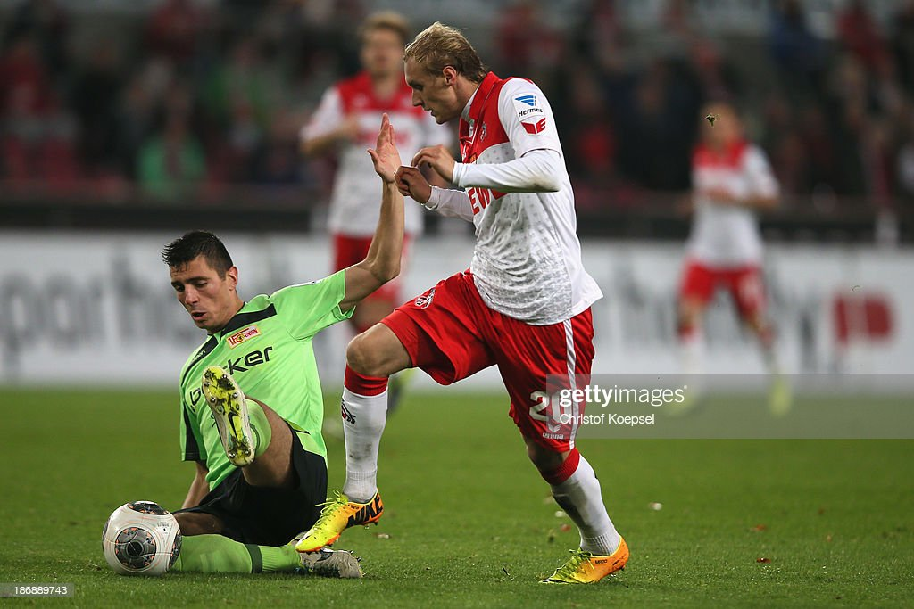 Damir Kreilach of Union Berlin challenges <a gi-track='captionPersonalityLinkClicked' href=/galleries/search?phrase=Marcel+Risse&family=editorial&specificpeople=4331527 ng-click='$event.stopPropagation()'>Marcel Risse</a> of Koeln during the Second Bundesliga match between 1. FC Koeln and 1. FC Union Berlin at RheinEnergieStadion on November 4, 2013 in Cologne, Germany.