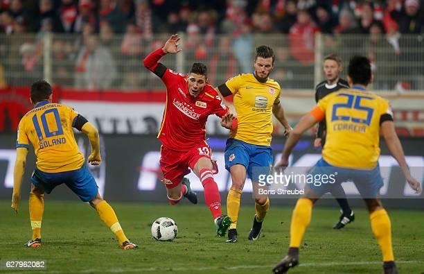 Damir Kreilach of Union Berlin is challenged by Quirin Moll of Eintracht Brauschweig during the Second Bundesliga match between 1 FC Union Berlin and...