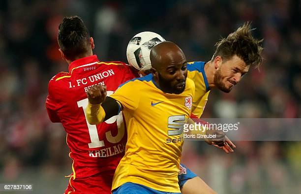 Damir Kreilach of Union Berlin jumps for a header with Domi Kumbela and Quirin Moll of Eintracht Brauschweig during the Second Bundesliga match...