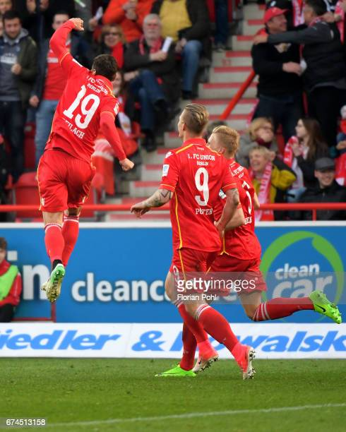 Damir Kreilach Sebastian Polter and Kristian Pedersen of 1 FC Union Berlin celebrate after scoring the 20 during the game between dem 1 FC Union...