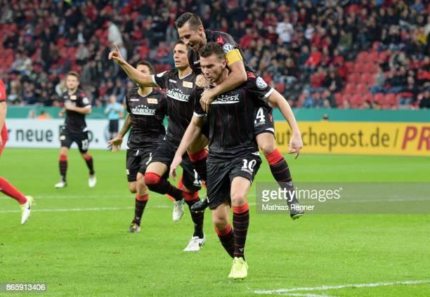 Damir Kreilach Steven Skrzybski and Dennis Daube of 1FC Union Berlin celebrate after scoring the 11 during the game between Bayer 04 Leverkusen and...