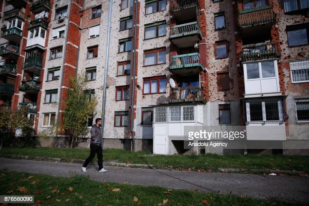 Damir Vatres who lost his hand in the explosion of a toylooking mine left in the Dobrinja district in the capital Sarajevo poses during an exclusive...