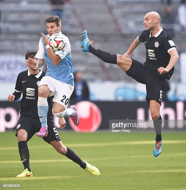 Damir Vrancic of Braunschweig is challenged by Valdet Rama of 1860 during the 2 Bundesliga match between 1860 Muenchen and Eintracht Braunschweig at...