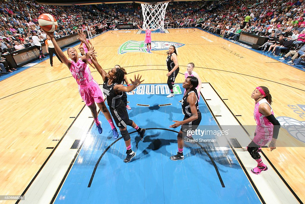 <a gi-track='captionPersonalityLinkClicked' href=/galleries/search?phrase=Damiris+Dantas&family=editorial&specificpeople=6867966 ng-click='$event.stopPropagation()'>Damiris Dantas</a> #34 of the Minnesota Lynx goes for the shot against the San Antonio Stars during the WNBA game on July 25, 2014 at Target Center in Minneapolis, Minnesota.