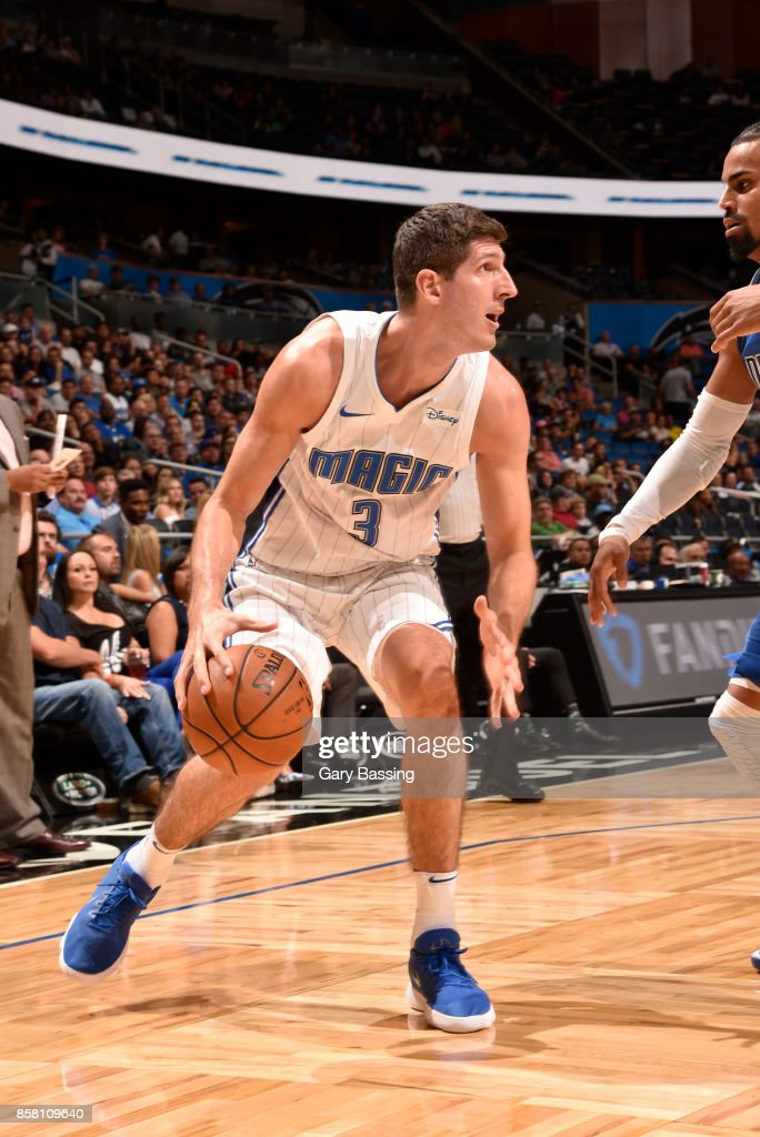 Damjan Rudez #3 of the Orlando Magic handles the ball against the Dallas Mavericks during a preseason game on October 5, 2017 at Amway Center in Orlando, Florida.