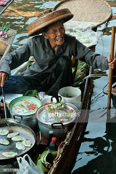 Damnoen Saduak a provincial district of Rajburi Province Most people live along both sides of the canal fmany of them agriculturists Thanks to th...
